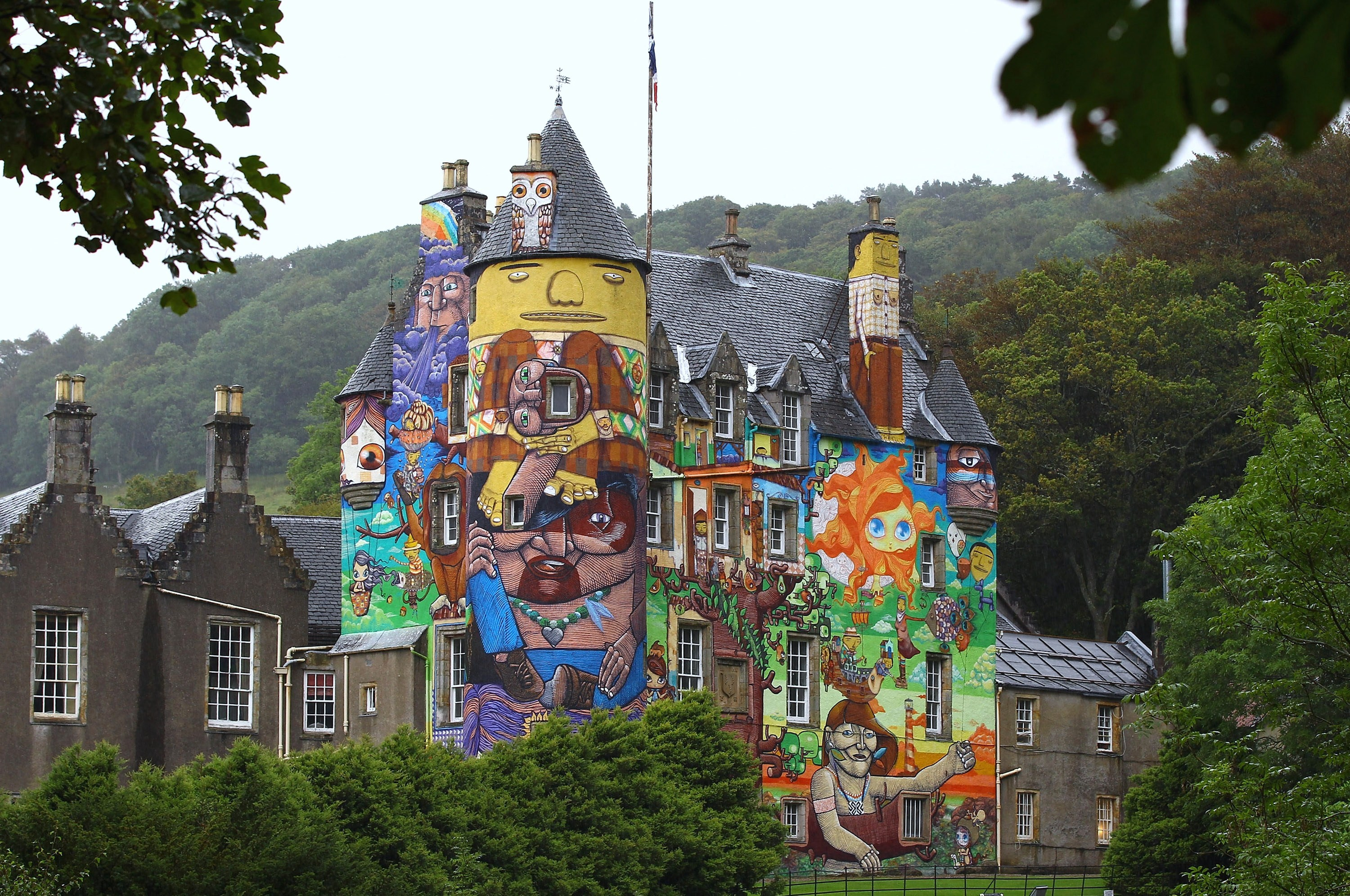 LARGS, SCOTLAND - AUGUST 30: A general view of Kelburn Castle on August 30, 2011 in Largs, Scotland. The Earl of Glasgow has asked Historic Scotland if the graffiti can remain as a permanent feature of the Castle. The local council allowed the mural to be painted on the wall by Brazilian artists in 2007, with a three year limit put on the graffiti pending the start of rendering work at the castle. (Photo by Jeff J Mitchell/Getty Images)
